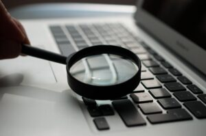 magnifying glass on top of laptop keyboard